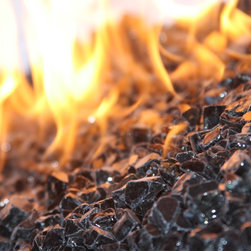 "American Fireglass Black | 1/2-in Fire Glass | 10 lbs - Perfect for outdoor fire pits and fireplaces Provides unequaled versatility: available in a multitude of colors & sizes Glass Gems are tempered for long term heat exposure - Thanks to the special manufacturing process Fireglass Gems retain their color and actually burn cleaner than gas logs 1/2"" BLACK FIREGLASS is available in our 1/2"" Collection. It is a great addition to a fireplace with light colored walls which allows the magnificent polished glass to stand out against the light colored backdrop. Black is our top recommended color when using L.P (liquid propane) due to carbon soot that may build up over time however is not noticeable on the black fireglass. An Average 36"" Fireplace Takes Approximately 60 lbs. of gems An Average 42"" Fireplace Takes Approximately 80 lbs. of gems Lava granules can be used initially on the burner then covered with Fireglass Gems to reduce the amount needed Gems are sold in 10 bags Combine multiple gem colors for spectacular fire!"