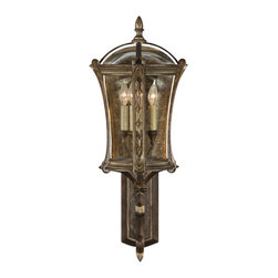 Fine Art Lamps - Gramercy Park Outdoor Wall Mount, 572181ST - The antique gold finish on this special wall mount brings a touch of dramatic warmth to the outside of your home. The amber-tinted glass casts a beautiful light, and the detailed hardware reflects an old-world charm and sophistication. A pair of these would look great on either side of a garage door or front porch.