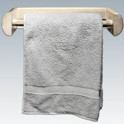 "Montana Woodworks - Montana Towel Rack, Lacquered - Add to the rustic ambiance in your home with this delightful towel rack. Handcrafted using solid, American grown wood, this towel rack is the perfect fit in the kitchen, bath or with the Montana Woodworks bar. Hand peeled for that unique, one-of-a-kind look that shows your rustic side. Comes fully assembled. 20-year limited warranty included at no additional charge. Hand Crafted in Montana U.S.A.; Solid, U.S. grown wood; Skip-peeled by hand using old fashioned draw knives.; Heirloom Quality; 20 Year Limited Warranty; Durable Build, Fit and Finish; Each Piece Signed By The Artisan Who Makes It; Solid genuine lodge pole pine; Solid Wood Design is Perfect for Bath or Kitchen. Dimensions: 21""W x 6""D x 4""H"