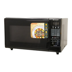 Sharp - 1.5 CF, 900 Watts, Convection, Sensor Interactive - 900-watt convection microwave oven with 1.5 cu. ft. capacity|4-way convection system: browns, bakes, broils and crisps|15.4 inch turntable and 2 stainless steel racks|7-digit, interactive, 2-color display|Lighted stainless steel oven interior|CompuBroil, CompuRoast, CompuBake and CompuDefrost|Temperature control in 25-degree increments|Smart & Easy Sensor automatically determines heating times and power levels|Programmable 4 stage cooking with 11 variable power levels|Reheat and popcorn sensors|  sharp| r-903ak| r930ak| r 930ak| microwave| convection| oven| 1.5| cu| ft| 900w| 900-watt| 900-watts| 900| w| watt| watts| stainless| steel| interior  Package Contents: microwave|turntable|turntable support|2 racks|manual|warranty  This item cannot be shipped to APO/FPO addresses  Sharp will no longer take back any Sharp product as a DOA.