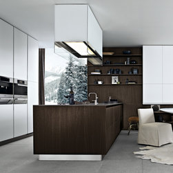 Varenna by Poliform - Varenna by Poliform Twelve Kitchen Cabinetry - Twelve is a result of research into a new essential design which is characterized by minimal horizontal thicknesses and maximum width of the surfaces. Primary volumes are expressed by the absence of handles. The cabinets are available in a variety of colors and finishes of wood, laminate, embossedor glossy lacquered MDFand non-imprint steel. Available wood finishes include walnut, canaletto, white or black pine, dyed wenge oak, oak, siena oak, brown oak, Spessart oak, dyed grey oak, acacia, ovangkol and ebony.