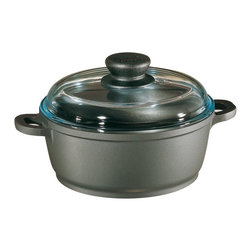 Berndes - Berndes Tradition 7 qt. Dutch Oven with High Dome Cover Multicolor - 674030 - Shop for Dutch Ovens from Hayneedle.com! Your next dinner party will be a breeze because cooking delicious meals for a larger group is easy and healthy when using the Berndes Tradition 7 qt. Dutch Oven with High Dome Cover.The Tradition 7 qt. Dutch Oven with High Dome Cover will help you cook your favorite recipes including casseroles. All Berndes cookware is made with superior vacuum-pressure cast aluminum. The non-stick surface is designed to never chip crack blister or peel and will prevent your favorite foods from sticking to the pan. Oils and cooking sprays are not needed so healthy meals are easy to create.About Berndes.Founded in 1921 Berndes has designed and manufactured high-quality functional and practical cookware. Their products stand out among the rest. Berndes provides consumers with a complete range of cookware including: high-tech non-stick cast aluminum cookware heavy-gauge aluminum non-stick pans clay cookery and stainless steel cookware.The Berndes name is associated with superior quality and innovative cookware available for any taste type and budget. With a sense of responsibility for mankind and the environment Berndes makes sure that environmental protection plays an important role in the corporate policy as they go above and beyond environmental protection laws. The Berndes Environmental Declaration was one of the first in the household goods sectors to be declared valid by Gerling Cert Umweltgutachter GmbH Cologne in 2000.Range Kleen Mfg. Inc. located in Lima OH is the official retail distributor of Berndes brand cookware throughout the United States.