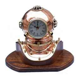 "Copper Divers Helmet Clock, 12"" - The Hampton Nautical Copper Diver's Helmet Clock is great nautical decor and sits well on areas such as a desktop or a mantle. The diver's helmet, featuring a working quartz clock, is a copper miniature of our bigger diver helmet. The Copper Diver Helmet Clock rests nicely on a high quality solid hardwood base that has a polished finished. A blue felt is placed on the bottom of the diver helmet clock base so it can rest on any surface without damage."