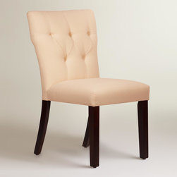 World Market - Twill Tufted Gabie Dining Chair - Featuring an hourglass silhouette with a low-profile back and diamond tufting, our custom-made dining chair is handcrafted in the U.S.A. of solid pine wood with soft cotton upholstery. Accentuate your dining decor with this comfortable and on-trend chair in your choice of colors, mix with your current chairs, or pair it with a vanity or accent table.