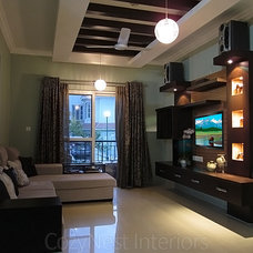 Contemporary Living Room by CozyNest Interiors