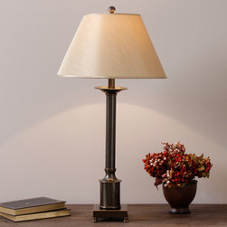 None - Column Table Lamp - The classic columnar shape of this elegant table lamp makes this a versatile piece that pairs well with traditional and modern decor. The sturdy metal base has a warm antiqued bronze finish and is accented by an ivory fabric lampshade.
