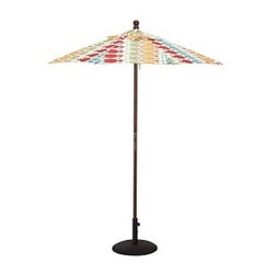 Round Market Umbrella with Eucalyptus Pole, 6', Adele Ikat - Vibrant, sun-drenched colors make these umbrellas summer favorites. Choose from our three types of poles to help you complement outdoor furnishings. 6' diameter, 7.4' high 9' diameter, 8.25' high Canopy made of fade-resistant polyester canvas. Wood pole is crafted from eucalyptus or premium teak, and features an easy-to-use pulley system, and three positions for the galvanized-metal locking pin that keeps the umbrella open. Sturdy aluminum pole in bronze finish has an easy-turn crank handle and tilt function. Choose eucalyptus, teak or aluminum pole. Designed to fit any Pottery Barn outdoor dining table that accommodates an umbrella. Please check umbrella pole diameter if using with other tables. Concrete stand (sold separately) can be used with any of our umbrellas for added stability. Simple assembly. Imported. Read more on our blog about the inspiration behind this product. View our {{link path='pages/popups/fb-outdoor.html' class='popup' width='480' height='300'}}Furniture Brochure{{/link}}.