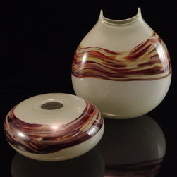C&H Products - Our Manta vases feature a contemporary flattened profile, rounded edges, and fun peaks adding visual interest to the neck of each piece. Our Zen vase features a low bowl feel with a very contemporary Asian look. Zen vase $190. Manta vase $325. We have many other colors available. Check out our website or call us for a catalog. C&H Glassworks