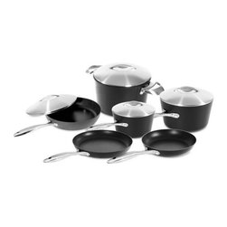 Scanpan Professional 9 Piece Cookware Set - When you need a nonstick cookware set  the Scanpan Professional 10 Piece Cookware is ready to take on every job.  With the versatile selection of cookware included in the 10 piece set  cooking for your family will be a breeze  and when it comes time to clean up  it's a snap!  Just toss these in the dishwasher  the ceramic titanium coating can take anything you throw at it.  This set includes everything you need to fully equip your kitchen.  Scanpan Classic cookware is designed for high-heat cooking such as frying  searing or sauteing  and heats evenly. Scanpan Professional cookware is designed for consumers in need of kitchenware that looks and performs beyond the ordinary  the Scanpan Professional series fry pans heat evenly  and the sloped sides allow you to easily turn and flip food.  Just like all Scanpan Cookware  it is manufactured with a patented ceramic-titanium nonstick technology that is completely PFOA free throughout the entire manufacturing process.  The ceramic titanium coating gives you incredible nonstick performance along with a nonstick skillet that isn't afraid of metal utensils! Made in Denmark. Full lifetime warranty. Dishwasher safe.Set includes8 Inch fry pan11 inch fry pan1 quart covered sauce pan3 quart covered sauce pan10 1/4 inch covered saute pan6.5 quart covered stock potProduct FeaturesMade from 100% recycled squeeze-cast aluminumPatented ceramic titanium with PFOA-free non-stick surface allows the use of metal utensilsOven safe up to 260°C/500°F18/10 stainless steel cast handlesLifetime WarrantyEco friendly ceramic titanium surface will never peel even with the use of metal utensils
