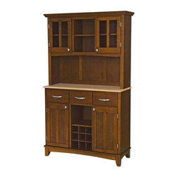 HomeStyles - Buffet w Hutch in Cherry Finish - A country flourish is at home in many types of decor. The classic styling of this buffet includes a rich cherry finish and contrasting serving surface. The hutch is sure to become a favorite spot for displaying collector plates and other heirloom treasures in the dining room. * Buffet with three utility drawers. Two wood framed cabinet doors with an adjustable shelf for plenty of inside storage. Center wine storage area. Hutch with two wood framed plexiglas doors with an adjustable shelf inside. Center area with one shelf. Brushed steel hardware. Adjustable floor levelers. Made from Asian hardwood. Made in Thailand. Assembly required. 44 in. W x 17 in. D x 72.25 in. H