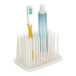 Umbra - Umbra Grassy Organizer - The Umbra rubber Grassy organizer in white is a whimsical fun way to organize your toothbrushes and toothpaste. Great for adult and kid's bathrooms alike, this grassy organizer is made of rubber and easy to clean. You can also use the Grassy organizer in your office to hold pens and pencils. Innovative design. Umbra is the worldwide leader in casual, contemporary and affordable design for the home.