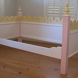 Cottage Daybed - I love the whimsical design of this daybed for a fantasy room. Because it is custom-made to order, you can pick the colors for the individual posts, spindles and backboards.