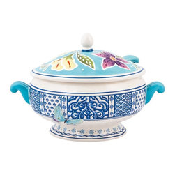 Fitz and Floyd - Fitz and Floyd 29-529 Courtyard Tureen with Ladle - 29-529 - Shop for Bowls and Candy Dishes from Hayneedle.com! The traditional look of blue and white serving pieces gets a colorful natural update in the Fitz and Floyd 29-529 Courtyard Tureen with Ladle. Part of the Courtyard series this classic design features a lid with bright happy flower accents. Comfortable handles make it easy to carry and the earthenware construction makes for a durable piece.About Fitz and FloydFitz and Floyd is recognized worldwide as a leader amongst the style- and quality-conscious. For 50 years their unique designs have made them the leader in the purveyor of hand-painted ceramic dinnerware tableware accessories giftware and collectibles. All Fitz and Floyd pieces are easy to spot. Each piece is distinctively hand-crafted by artisans from the drawing board to the sculpting wheel and kiln.The company's Dallas-based studios are renowned for producing over 500 unique designs per year. Creations range from presidential dinnerware for the White House or a tea service for Her Majesty Queen Elizabeth II to the perfect centerpiece for your table and each design is lovingly crafted in the highest quality. Meticulous craftsmanship and exquisite detail make every Fitz and Floyd piece a treasured heirloom-quality gift.