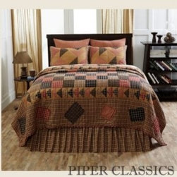 "Homestead Quilted Bedding - Homestead bedding is a rendition of the traditional flying geese patch motif, framed with frayed-edge ""repair"" patches appliqued on the quilt border. It has 100% cotton shell and fill, hand quilted with ""stitch in the ditch"" quilting. This product ships directly from our supplier."