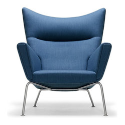 Carl Hansen & Son - Wegner CH445 Wing Chair Blue Fabric, by Carl Hansen - Watch out — this wing chair looks like it actually might take flight. A creation of renowned Danish modern master Hans J. Wegner, it boasts a solid beech frame, sturdy yet slim stainless steel legs and your choice of leather or fabric upholstery. No safety belt, though!