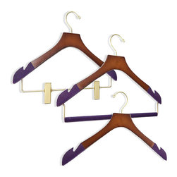 "Frontgate - Women's 38-pc. Executive Hanger Collection - Available in 100% birch wood with high-gloss Bubinga Finish, purple flocking, and brass hardware or 100% maple wood construction with satin finish, black flocking, and chrome hardware. Available in two different widths (petite and standard) for optimal sizing. Suit hangers feature 1-3/4"" shoulder flare, providing heavy and delicate shoulder garments with extra support to protect shoulder construction and shape. Skinny hangers measure 3/8"" wide. Felted trouser bars eliminate the creasing caused by ordinary locking-bar mechanisms. Protect and extend the life of your most important wardrobe items with our Luxury Executive Women's Hanger Collection. This premier set includes three suit/jacket hangers with felted trouser bars, five skinny shirt hangers with clips, five skinny shirt hangers with felted bars, and 25 skinny shirt hangers without bars. Felted and notched shoulders on all hangers securely, gently grip garments to prevent stretching and keep wide-neck garments from sliding off the hangers.  .  .  .  .  . Clips gently grip skirts and shorts without damaging delicate fabrics . All hangers eliminate shoulder dimpling, which is caused when hangers do not extend all the way to the edge of the shoulder ."