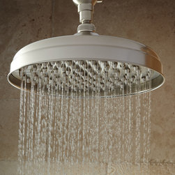 Lambert Rainfall Nozzle Shower Head With Ornate Arm - The Lambert Rainfall Nozzle Shower Head simulates the relaxing effects of a natural downpour, thanks to a series of nozzles set across its face. Includes wall-mount shower arm.