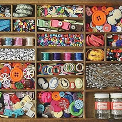 The Sewing Box Puzzle - 500 Piece Jigsaw PuzzleWithin each little box of tiny sewing notions you'll find a challenge in composition, color and pattern. From graphic shapes to the grid pattern of the box, this is a 500-piece puzzle that will test even the best puzzler.