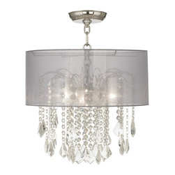 "Vienna Full Spectrum - Traditional Nicolli Clear 16"" Wide Sheer Silver Crystal Ceiling Light - The Nicolli Clear semi-flushmount ceiling light features clear crystal elements and a chrome finish frame. The four-light design offers the timeless look of a chandelier and is updated with a stylish designer sheer silver drum shade. A wonderfully refreshing designer look for your living space.  Chrome finish frame and canopy. Sheer silver drum shade. Clear crystal. Semi-flushmount ceiling light. Takes four 60 watt candelabra bulbs (not included). 19"" high. Chandelier only is 12"" wide 10"" high. Shade is 16"" wide 7"" high. Canopy is 5"" wide. Some assembly required; instructions included.  Chrome finish frame and canopy.  Sheer silver drum shade.  Clear crystal.  Semi-flushmount ceiling light.  From the Vienna Full Spectrum crystal lighting collection.  Takes four 60 watt candelabra bulbs (not included).  19"" high.  Chandelier only is 12"" wide 10"" high.  Shade is 16"" wide 7"" high.  Canopy is 5"" wide.  Some assembly required; instructions included."
