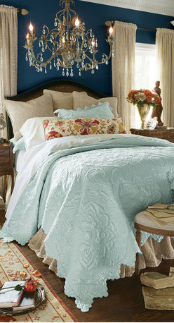 Spa Blue Chantelle Quilt - Inspired by romance, designed with love. Our Chantelle Quilt was meticulously crafted to loftily, lastingly rise above all other options. From the extraordinary softness and supple hand of its sateen fabric... to the intricate swirls and palmette medallions sculpted throughout like so much neoclassical friezework... to the in-kind complement of intricately sculpted scallops