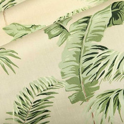 Negril Tropical Fabric in Taupe - Negril Tropical Fabric in Taupe is a leaf print, 100% Combed Cotton Percale with a neutral base suitable for upholstery, drapery, or bedding and pillows. The large tropical leaves on this smooth fabric will transport your interior to a warm, tropical setting. European made with a width of 54″ and a repeat of 25.25″. Passes 30,000 Wyzenbeek Double Rubs.