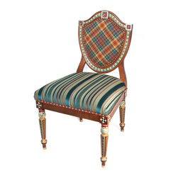 Highland Shield Back Chair   MacKenzie-Childs - As close as we get to a coat of arms! The back of our Highland Shield Back Chair is upholstered in our exclusive MacKenzie tartan plaid surrounded by multi colored braided trim. The seat is upholstered in rich teal, eggplant, and gold striped velvet and trimmed with a band of red leather, adorned with individually tacked brass nailheads. Hand-painted legs feature a diamond motif painted in red and teal, and accented by orange and gold. Each leg ends in a brass cap. Imported frame, hand decorated in Aurora.