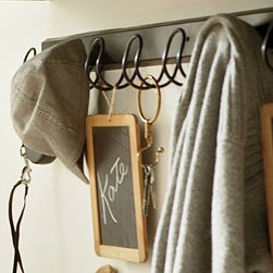 """Kellan Wall-Mount Row of Hooks - Finished in deep bronze for a crisp, modern aesthetic, our Kellan row of hooks brings style to organization. Eight wire-loop hooks across a thick wooden plank create the perfect home for jackets, bags, hats or scarves. 48.5"""" wide x 3.5"""" deep x 4.5"""" high Crafted of steel with a rustic bronze finish. Mounting hardware included."""