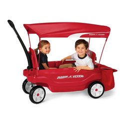 Radio Flyer - Radio Flyer Odyssey Ultimate Comfort Kids Wagon - 3181 - Shop for Wagons from Hayneedle.com! More fun and more versatile than a regular stroller the Radio Flyer Odyssey Ultimate Family Wagon can be used in five different configurations for convenient hauling of kids or the gear that goes with them. Two kids can sit in the wagon in cozy padded seats with safety belts; handy storage pockets and molded-in cup holders keep juice boxes snacks and toys right at hand for a more enjoyable ride. Flip one seat down and use the other half of the wagon as a covered storage area extra large open storage area or as a tray table so your child can play or dine solo as you travel. Fold both seats for use as a flatbed wagon perfect for hauling oversized toys around the yard.The full-length canopy protects kids from harmful UV rays on sunny days and removes in seconds with the Quick-Clip attachment system when not needed. Parents will appreciate the two adult cup holders in the front and the soft-sided rear storage bag which expands to accommodate your picnic lunch and beach towels. The extra large quiet tires are equipped with front axles that are designed for non-tip turning ensuring that the wagon's precious cargo doesn't fall over and make you question your parenting skills.Dimensions Body: 41.5L x 18.5W x 13.75H inchesWheels: 10 x 2.5 inches