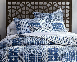 Hand-Blocked Mosaic Quilt + Shams - Out of the blue. Using traditional techniques certified by the nonprofit organization Craftmark, the master artisans in north Indian's Rajasthan hand print the tribal geometrics of this reversible bedding and then hand quilt it to finish each piece. The resulting designs, no two of which are exactly the same, create a bold, graphic mosaic for the bed. With its light cotton fill, the quilt is great on its own in spring, summer and fall and makes a perfect layering piece in the colder months.