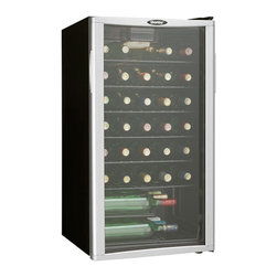 Danby - 35 Bottle Wine Cooler, Reversible Door, Tempered Glass Door, Worktop - The Danby DWC350BLPA 3.2 Cu. Ft. 35-Bottle Free Standing Wine Cooler is an economical and convenient way to cool and store wine. This model offers a generous 35 bottle capacity and includes interior display light to show off your collection. It features 5 slide-out shelves and 1 staggered shelf. Plus you get an enhanced view of the interior through the shatter-resistant tempered glass door. The door is reversible and comes with a stylish platinum trim to complement the all black cabinet. 35 bottle (3.2 Cu. Ft.) capacity