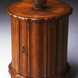 Butler - Drum Table in Vintage Oak Finish - Vintage Oak finish. Selected solid woods, wood products and choice veneers. Hand carved details. Maple, walnut and cherry veneers inlay top with oak veneer border. Door with antique brass finished hardware. 22 in. W x 22 in. D x 24.5 in. H