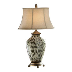 Uttermost Malawi Cheetah Print Table Lamp - Burnished cheetah print over a ceramic base with heavily antiqued silver details. Burnished cheetah print over a ceramic base with heavily antiqued silver details. The oval bell shade is an oatmeal linen fabric with natural slubbing.