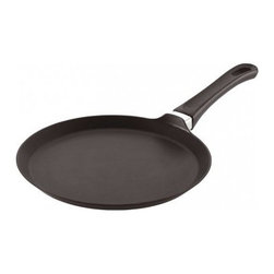 Scanpan Classic 10 in. Omelette/Crepe Pan - Eco-friendly cookware from SCANPANSCANPAN wants to make a difference in your kitchen and in the environment. They manufacture cookware with respect for people's well-being, using environmentally responsible methods and materials. They strive to minimize the environmental impact of their production process from their factory in Denmark by using stainless steel and 100% recycled aluminum. Using recycled aluminum saves a lot of waste (85.4 kilos per 1 kilo of aluminum, in fact) and creates less waste than other materials. Recycling aluminum also uses considerably less energy in the production process compared to new aluminum. SCANPAN was the first cookware manufacturer to bring environmentally friendly, PFOA-free products to the market. Today, all SCANPAN products are free from both PFOA and PFOS, preventing the transfer of harmful chemicals to your cooking. The achieve this and mage to deliver the best performing cookware on the market.About SCANPANA manufacturer of eco-friendly cookware, SCANPAN is one of the world's leading manufacturers of non-stick products and has been producing Danish kitchenware of the highest quality and durability for over five decades. Sticking to their roots in traditional craftsmanship, SCANPAN creates functional and timeless tools for modern kitchens. With a brand that's constantly evolving, they're proud to be at the forefront of innovation and technology. Since their inception in 1956, their hand cast aluminum products with patented coating have formed the core of their business. To this day, they still cast all of their own non-stick aluminum products at their own factory in Denmark.