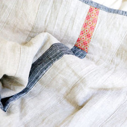 Throw Sized Quilt - Famous for her one-of-a-kind rag dolls, Jess Brown has recently launched a home line as well. Among my favorites in this impressive collection are these sublime handmade quilts, fashioned from vintage linen.