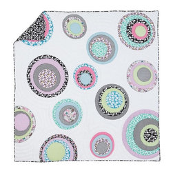 Circle Stitch Quilt - This quilt has a real bohemian vibe with all of its multicolored rings and circles.