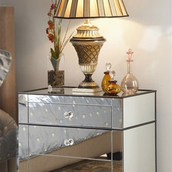 Chelsea Nightstand - Nightstand has mirrored sides and front and wood legs and edging. Three drawers with single knob pull.
