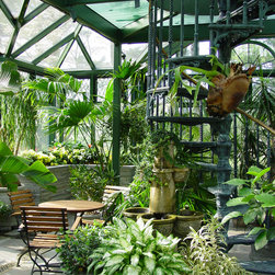 Greenhouse - The fountain adds the sound of running water and the planting beds and planters with their fragrant flowers add a series of wonder scents.