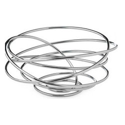 Inova Team -Modern Chrome Fruit Bowl - Made from a single piece of chromed steel wire, this sophisticated bowl adds a sculptural element to any table while serving a functional purpose. Elegant and modern, the swirling and curving lines seem to orbit around the contents inside. Showcase seasonal fruit, decorative objects or leave empty. Designed by the Anglo-Swiss design duo Dan Black and Martin Blum.