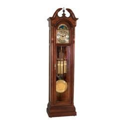 """Ridgeway Clocks - Pierced Moon Dial with Raised Arabic Numeral - This grandfather clock features a pierced moon dial, which is illuminated by interior lighting to give the appearance of twinkling """"stars."""" The dial is ornate, with accents of gold, and a polished pendulum swings beneath a set of brass-finished weights. The piece is completed by an impressive burl image located on the back of the panel. * An elegant swan neck pediment with a fully turned finial, decorativeshell overlay and raised burl veneer on the front crown look stunning inthe Glen Arbor Cherry finish on select hardwoods and veneers. . Reededposts with turned capitols surround the clock's dial and a detailedembossed molding runs along the bottom of the front locking door.. A functioning pierced moon dial with raised Arabic numerals,decorative embossed center and corner designs compliment the matchingbanded weight shells and lyre pendulum with 10 5/8"""" (270mm)embossed center disk. . A fancy burl image on the back panel is highlitedby an internal light and completes the ensemble and can be viewed fromthe side glass panels and the locking front beveled glass door.. A triple chime cable driven movement plays Westminster, Whittingtonand St. Michael's chimes and can be silenced through the night with anautomatic night silence option.. H 84""""(214cm), W 22""""(56cm), D 13""""(33cm)"""