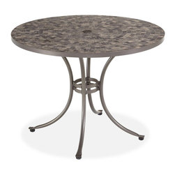 Home Styles - Home Styles Glen Rock Marble Top Patio Dining Table Multicolor - 5607-30 - Shop for Tables from Hayneedle.com! Beautifully designed and expertly crafted the Home Styles Glen Rock Marble Top Patio Dining Table is a sophisticated and luxurious addition to your home. With a gently curving base crafted from strong powder coated steel in a gray finish you know that this patio table is made to last. With varying shades of gray throughout the hand-crafted tumbled marble square tiles that make up the table top no two tables are alike. An umbrella hole in the center gives you the option of adding a splash of color or accenting shade to this gorgeous table. Nylon glides not only helps to protect your patio or deck from being damaged but also helps to provide stability on uneven surfaces. Stunning to look at you'll love entertaining friends and family alike throughout the warm summer months while enjoying the beauty of your backyard. Additional Features No 2 tables are alike Umbrella hole with cap Elegantly curved base Nylon glides helps to protect surfaces from damage Glides help to provide stability on uneven surfaces Some assembly required About Home StylesHome Styles is a manufacturer and distributor of RTA (ready to assemble) furniture perfectly suited to today's lifestyles. Blending attractive design with modern functionality their furniture collections span many styles from timeless traditional to cutting-edge contemporary. The great difference between Home Styles and many other RTA furniture manufacturers is that Home Styles pieces feature hardwood construction and quality hardware that stand up to years of use. When shopping for convenient durable items for the home look to Home Styles. You'll appreciate the value.