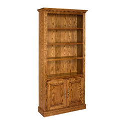 A and E Wood Design - A & E Solid Oak Britannia Wood Bookcase with Doors - BRIT36X84-M-W/DOORS-FLUSH - Shop for Bookcases from Hayneedle.com! The Britannia Deluxe Oak Bookcase with Doors is ideal in any room where you need extra storage for books DVDs and more. Available in 72- or 84-inch heights this bookcase features multiple adjustable non-bowing shelves made from 0.75-inch premium-grade oak plywood materials and tested to support up to 150 pounds each. Each shelf has mortise-and-tenon 0.5-inch solid oak detail trim for a stately look. The lower part of each unit has a dual-door cabinet that opens to reveal one adjustable shelf and one fixed shelf. In addition to optional side molding this bookcase also features sturdy top face frames and base and top molding all constructed from solid oak. The top edge of each bookcase has dentil molding trim and fluted side columns add even more elegance. Made with screw assembly the bookcases are strong and durable - not wobbly like cheaper versions. They also have heavy top and bottom trim casings and 0.25-inch recessed backs. Available in a medium-oak premium multi-coat durable lacquer finish to best match your existing decor. This bookcase can be customized with decorative wraparound molding or with flush sides for side-by-side display. Each bookcase is made in the USA and delivered fully assembled. See information below for size options. 72-Inch Bookcase With Doors 3 upper shelves; 2 adjustable 2-door cabinet with 1 adjustable shelf and 1 fixed shelf Weighs 119 lbs. Dimensions - Flush sides - 36W x 14D x 72H inches; with molding - 39W x 24D x 72H inches 84-Inch Bookcase 4 upper shelves; 3 adjustable 2-door cabinet with 1 adjustable shelf and 1 fixed shelf Weighs 129 lbs. Dimensions - Flush sides - 36W x 14D x 84H inches; with molding 39W x 14D x 84H inches About A and E Wood Design Inc.Based in Riverside Calif. A and E Wood Design Inc. specializes in providing quality wood furniture for the home and office. The company's b