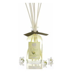"""Antica Farmacista - Lemon Verbena & Cedar Room Diffuser - Petite Size for a Petite Space"""" Our Antica's new collection of 100ml Home Ambiance Fragrances are approved for carry-on baggage, making this reed diffuser a great gift for an out of town guest or a fragrant reminder of home to bring along wherever life takes you. The perfect size for your personal space and the perfect price for your wallet.    Lemon, Verbena & Cedar - Invigorating notes of tart lemon, orange and lemongrass mingle with notes of fresh Italian verbena. White florals and the delicate earthiness of cedarwood round out this bright and complex citrus experience.     * 100 ml  * Complete with birch reeds and gift tag  * Made In Italy"""