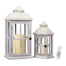 """Asian Import + USA - Heron Lantern Set with Flameless Color Candles - The natural beauty of candlelight deserves a great presentation, and this lovely set of wood lanterns has certainly taken this to heart. These look like they were once sitting at the entryway of an old country farmhouse. The lanterns are rustic but  traditional. You""""ll find just the right spot in your home to showcase them. Sizes are 17"""" and 24"""" high. Included are two 6"""" Avion Select melted edge color wax candles with remote control timer. Note that candles pictured are for presentation only. The candles included in the set are described above. Set of 2"""