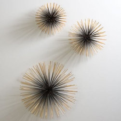 Global Views Boom Wall Sculpture - Resist the urge to go up to the Global Views Boom Wall Sculpture and blow the seed pods. They're not real. But they sure do look like dandelion seed pods, don't they? Available in three sizes, these decorative wall decorations shine in gold and black and are perfect for indoor use. They feature a hidden disc with security hardware screws for easy and safe installation. About Global ViewsGlobal Views is a provider of quality, fashion-driven home furnishings and accents from around the world. Their products range from decorative accents like candelabras and lighting fixtures to benches, chairs, and tables. High-end home decor magazines, such as Elle Decor, Metropolitan, and Traditional Home, have taken notice of the quality and style their products exhibit. Global Views products have also been featured on main-stream TV show sets, including Extreme Makeover Home Edition, HBO Golden Globe, SAG party, and the Apprentice.Always environmentally aware, all Global Views products are made of natural materials, and their packaging is recyclable. Global Views staff members make extra efforts to minimize their carbon imprint by making wise energy choices and promoting recycling programs, carpooling, and waste reduction programs.