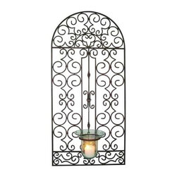 "Dr. Livingstone I Presume - Antique Brown Iron Garden Gate Hurricane Holder - The iron gate design artistically incorporates a glass hurricane holder at the bottom. Hand constructed and finished in antique brown, the garden gate design by Dr. Livingstone will add life and beauty to your wall. Try over a console table in a foyer to add the ambiance of candle light or on a larger wall flanked by some fabulous art. Holds up to 3"" x 6"" pillar candle. (DIL) 49.5"" high x 23.75"" wide x .5"" deep"