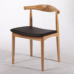 Handsome Dining Chair - This modern dining chair is not only handsome, but comfortable too.  Its curved back rest ensures solid support, while the sturdy design makes it a perfect staple for your home or office.  The wood frame and black leather seat lend a classic charm, while the shape makes it unique.