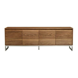 Gus Modern - Annex Credenza by Gus Modern - The Gus Modern Annex Credenza pairs the warmth of wood with cool stainless steel. This lengthy credenza is made out of walnut atop a brushed stainless steel perimeter base. It feature four self-closing doors fronting two storage compartments, both with adjustable shelves. Beveled pulls along the top of all the doors maintains the sleek, minimalist profile. Mid-century modern design interpreted with an industrial edge. Such is the modis operandi of Gus* Modern. Every accessory, sofa, sectional, chair and table they design is inspired by simple forms and honest materials. The resulting modern furniture pieces are clean, elegant and versatile, with crisply tailored upholstery and solid, eco-friendly FSC-certified wood frames. Founded in 2000, Gus* Modern is based in Toronto, Ontario, Canada.