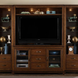 Liberty Furniture - Shadow Valley Entertainment Center - Floating top design. Warranty: One year. Made from poplar solids and figured cherry veneers. Bronze spice finishHutch:. Touch lighting. Adjustable shelf. Wire management provisions. TV space: 56 in. W x 13.75 in. D x 36 in. H. Middle top opening: 55 in. W x 12.5 in. D x 7.5 in. H. Overall: 60 in. W x 14 in. D x 48 in. H (115 lbs.)Pier:. Touch lighting. Three adjustable shelves. Two drawers. Inside pier space: 17.5 in. W x 13.5 in. D x 55.5 in. H. Adjustable glass shelves: 17.5 in. W x 11 in. D x 55 in. H. Overall: 22 in. W x 14 in. D x 82 in. H (181 lbs.)TV stand:. Tempered glass. Two adjustable removable shelves behind glass door. Boxed drawer construction. Three center drawers for storage. Wood-on-wood drawer glides. Brass patina knobs and pull hardware. Inside door space: 18 in. W x 19 in. D x 24 in. H. Adjustable shelves: 16.5 in. W x 16.5 in. D x 25 in. H. Overall: 60 in. W x 20 in. D x 34 in. H (130 lbs.)