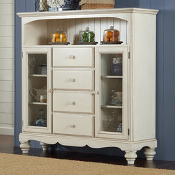 Hillsdale Furniture - Hillsdale Pine Island 4 Drawer Bakers Cabinet - Old White - 5265-854 - Shop for Buffets and Side Boards from Hayneedle.com! Pastoral elegance and practical features make the Hillsdale Pine Island 4 Drawer Bakers Cabinet - Old White a perfect choice for your living space. Four pull-out drawers let you keep things tidy. Two wood framed glass cabinet doors and an open shelf with beadboard backing provide beautiful display space. This solid pine beauty features a gracefully curved apron turned bun feet and comes in an Old White finish. About Hillsdale FurnitureLocated in Louisville Ky. Hillsdale Furniture is a leader in top-quality affordable bedroom furniture. Since 1994 Hillsdale has combined the talents of nationally recognized designers and globally accredited factories to bring you furniture styling and design from around the globe. Hillsdale combines the best in finishes materials and designs to bring both beauty and value with every piece. The combination of top-quality metal wood stone and leather has given Hillsdale the reputation for leading-edge styling and concepts.