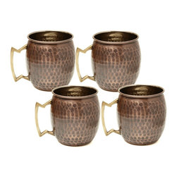 (Set of 4) 16 Oz. Antique Hammered Solid Copper Moscow Mule Mugs - This set of 4 unique and stylish solid copper mugs have a comfortable solid brass handles, making for easy lifting!   The mug of choice when serving  the famous Moscow Mule - a refreshing cocktail made of ginger beer, vodka and a dash of lime juice.